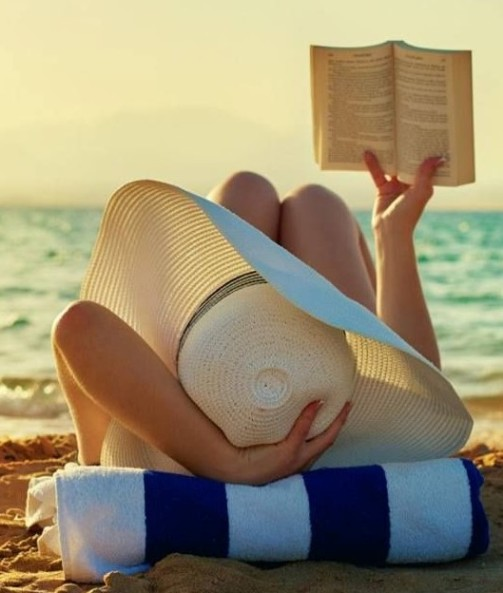 reading book on beach