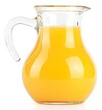 Orange juice in pitcher. Isolated on white background