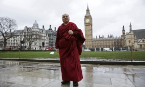 Former political prisoner Tibetan monk Golog Jigme poses for a photograph outside the Houses of Parliament in London