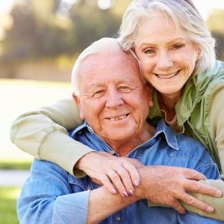 Outdoor Portrait Of Loving Senior Couple
